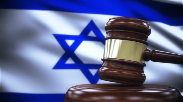 judge gavel with israel flag background - intellectual property stock videos and b-roll footage