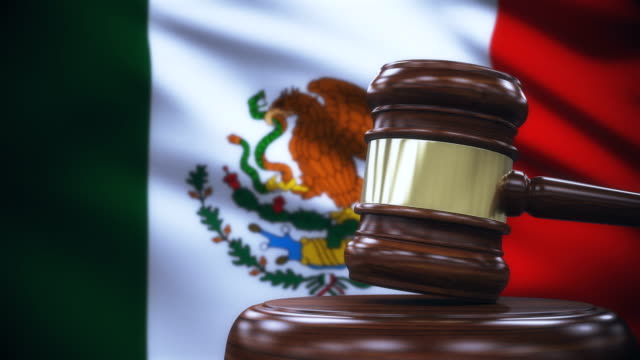 judge gavel with mexico flag background - criminal stock videos & royalty-free footage
