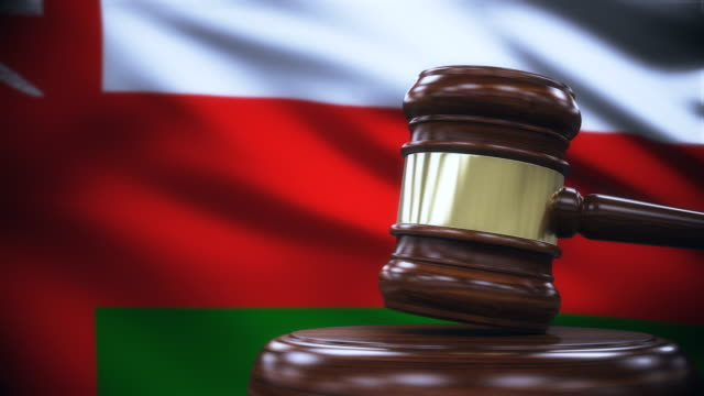 judge gavel with oman flag background - oman flag stock videos and b-roll footage