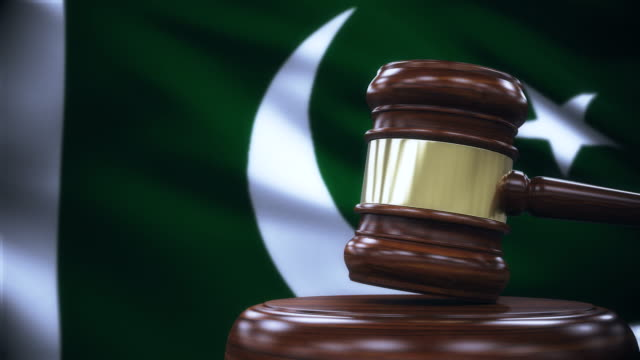 judge gavel with pakistan flag background - law stock videos & royalty-free footage