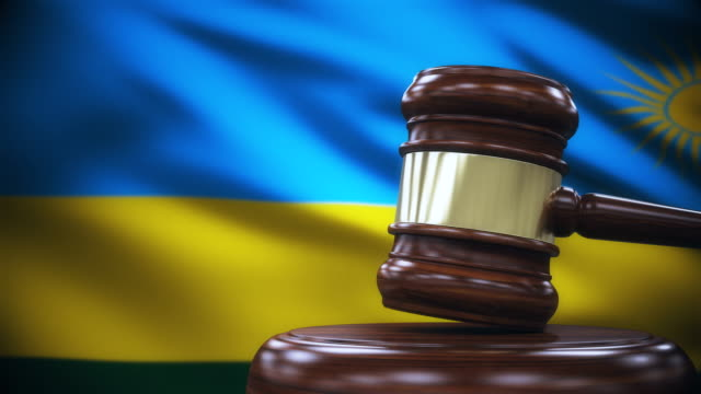Judge Gavel with Rwanda Flag Background