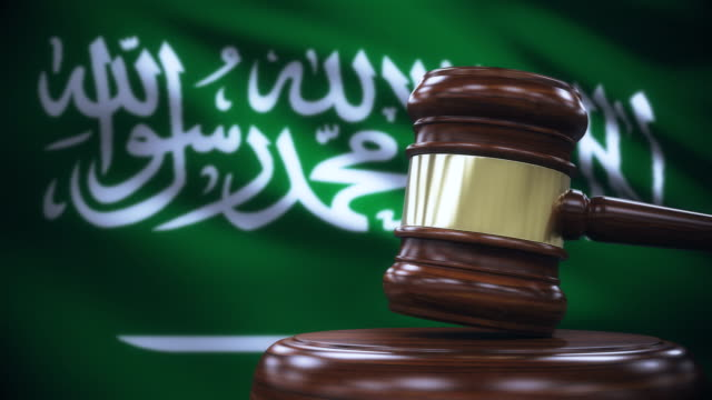 judge gavel with saudi arabia flag background - court stock videos & royalty-free footage