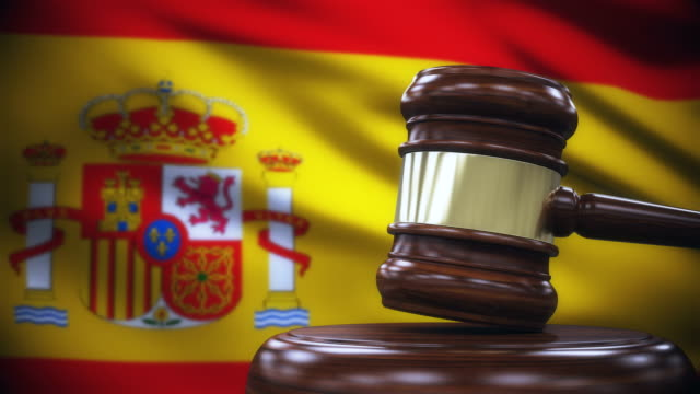 judge gavel with spain flag background - spain stock videos & royalty-free footage
