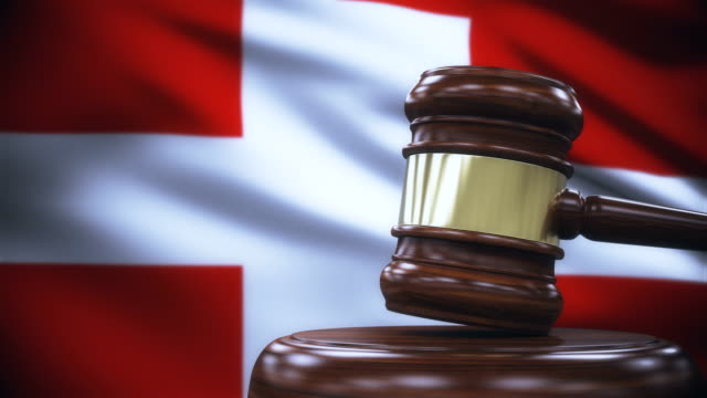 judge gavel with switzerland flag background - law stock videos & royalty-free footage