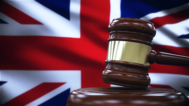 judge gavel with united kingdom flag background - gavel stock videos and b-roll footage