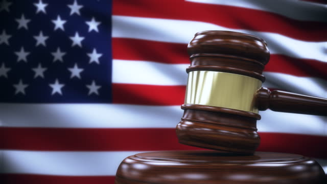 judge gavel with united states flag background - gavel stock videos & royalty-free footage