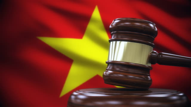 judge gavel with vietnam flag background - domination stock videos and b-roll footage