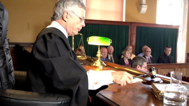 judge in court calling order with jury behind, courthouse - equal arm balance stock videos and b-roll footage