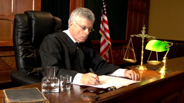 Judge in Court taking notes with USA flag, Courtroom