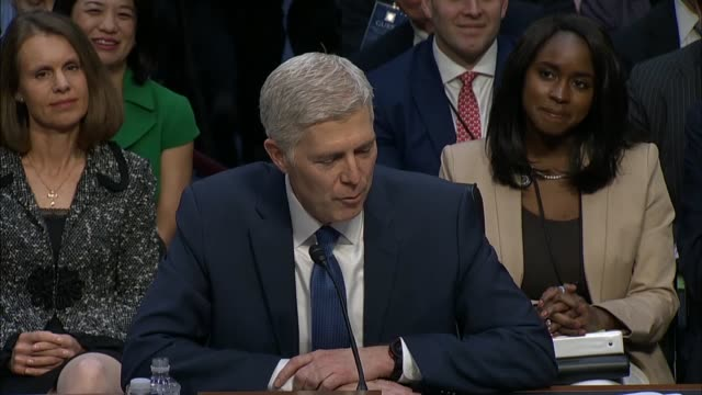 Judge Neil Gorsuch reads his prepared statement to the Senate Judiciary Committee on the first day of his confirmation hearing to become a Supreme...
