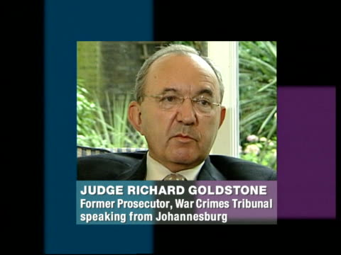 judge richard goldstone as goldstone phono interview overlaid sot - the attitude of the united states is nothing new / only hope things will change... - ラドヴァン カラジッチ点の映像素材/bロール