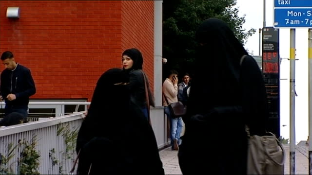 Judge rules woman must remove Muslim face veil when giving evidence T11091353 / TX Birmingham Female students wearing burkas along street