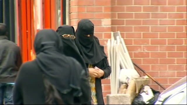 judge rules woman must remove muslim face veil when giving evidence t13071033 / tx blackburn two muslim women wearing headscarves along street two... - burka stock videos & royalty-free footage