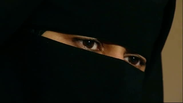 Judge rules woman must remove Muslim face veil when giving evidence T13071033 / TX Lancashire Blackburn INT Mid shot of Muslim woman wearing burqa...