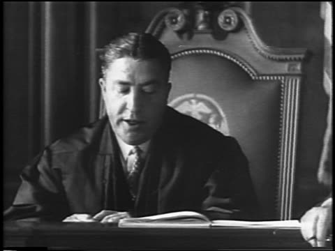 b/w 1935 judge sitting in courtroom reading sentence / lindbergh kidnapping / newsreel - 1935 stock videos & royalty-free footage