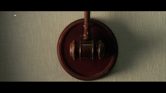 cu zi judges gavel hitting on wooden pad / unspecified - gavel stock videos & royalty-free footage