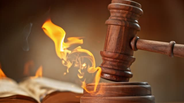 slo mo ld judge's gavel striking a burning wooden sound block - gavel stock videos & royalty-free footage