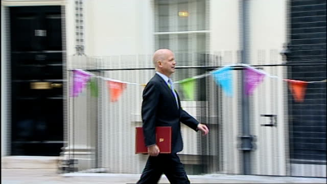 stockvideo's en b-roll-footage met judges hear claim uk intelligence used for drone strikes in pakistan lib london downing street william hague mp arriving at number 10 - william hague