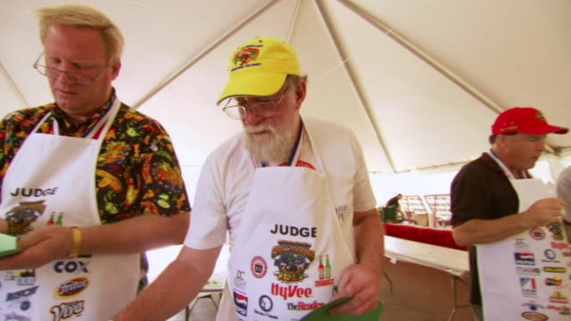 MS PAN Judges taking sample and notes during Worlds Championship Chili Cook off / Omaha, Nebraska, United States