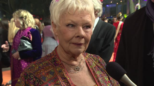 interview judi dench on dancing on set bollywood being very happy on set at 'the second best exotic marigold hotel' premiere at odeon leicester... - bollywood stock videos and b-roll footage