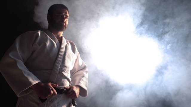 judokas 戦闘機抱き合わせブラック ベルト - 柔道点の映像素材/bロール