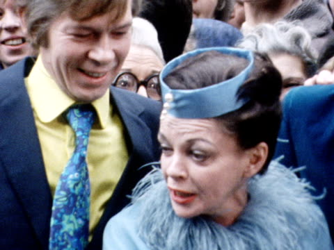 Judy Garland and Mickey Dean arrive at a London registry office for their wedding accompanied by their best man Johnnie Ray