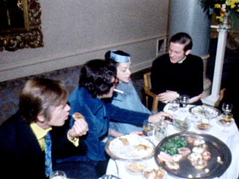 Judy Garland and Mickey Dean chat to one another during their wedding reception