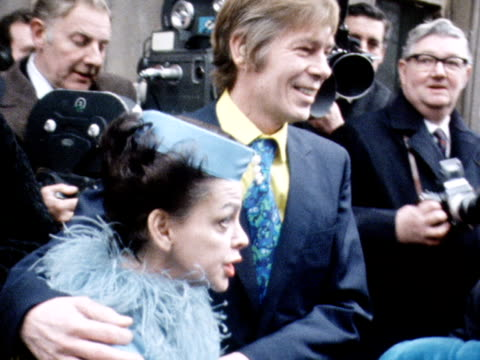 Judy Garland and Mickey Dean leave a London registry office following their wedding