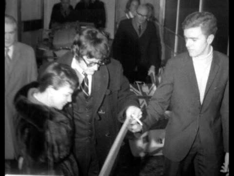 judy garland arrives lap; england: london: lap (london airport: int judy garland and mickey deans walk towards; she is handed write; they past l-r to... - judy garland stock videos & royalty-free footage