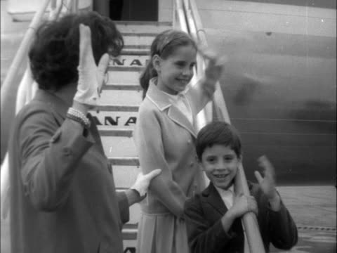 judy garland leaves ; england: london: lap : ext judy garlandf and 2 children lorna luft and joey luft wave from plane steps neg 16mm: brenards: tx... - judy garland stock videos & royalty-free footage