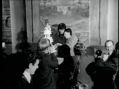 judy garland marries again; england: london: chelsea: int couple judy garland and mickey deans, and johnnie ray pose: out to cms: pose: lms couple... - celebrities video stock e b–roll