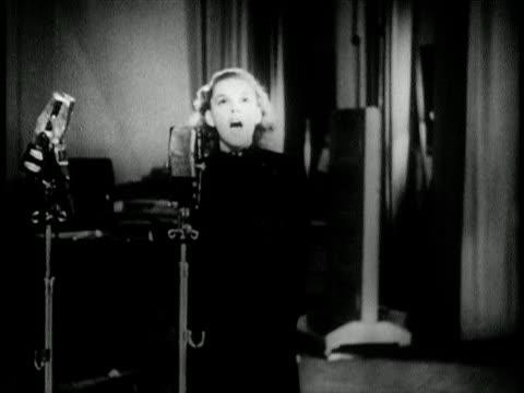 Judy Garland singing Over the Rainbow on radio / newsreel