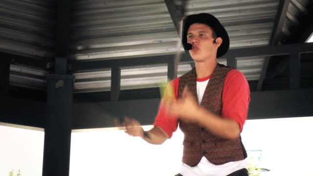 MS Juggler juggling battons and eating apple /  Mississauga, Ontario, Canada.