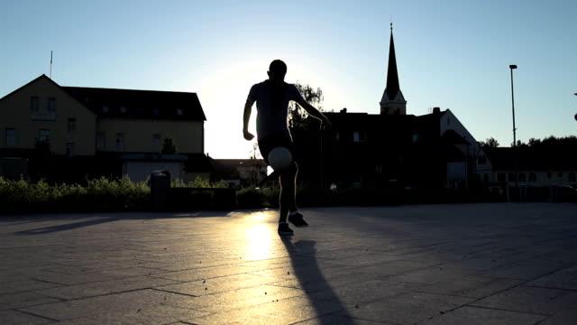 hd super slow-mo: juggling and kicking a ball - juggling stock videos & royalty-free footage