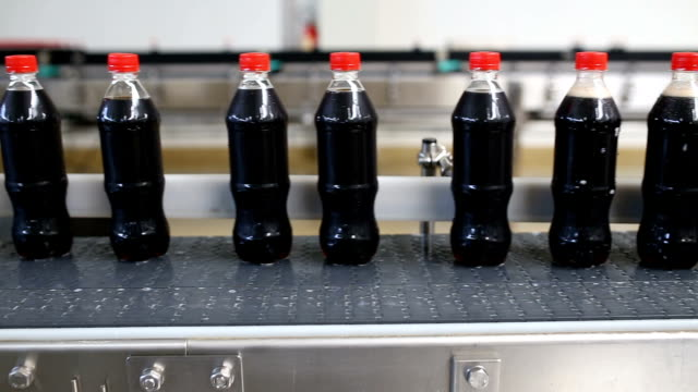 juice and soda production factory - bottling plant stock videos & royalty-free footage