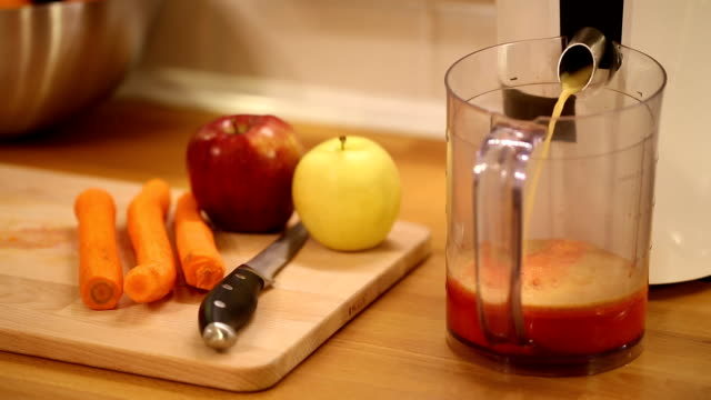 juicing at home - electric juicer stock videos & royalty-free footage