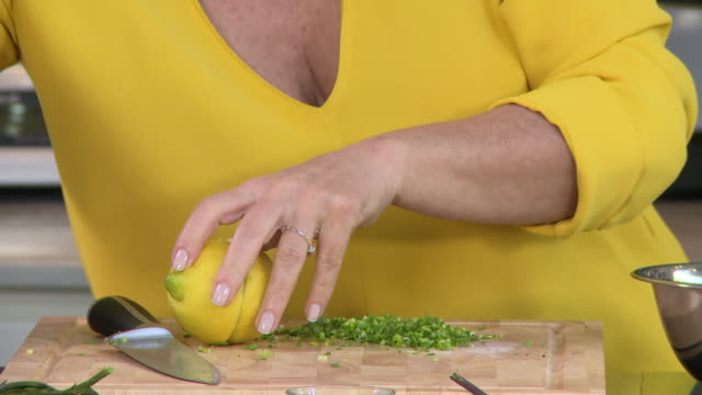 juicing lemons. view of a woman's hands juicing a lemon. - kitchen worktop stock videos & royalty-free footage