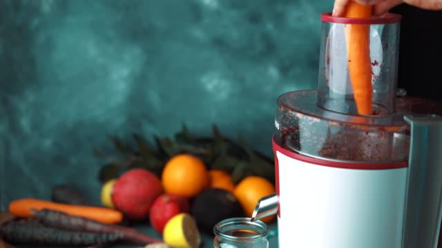juicing vegetable, carrot, black carrot, radish, turnip - juice extractor stock videos & royalty-free footage