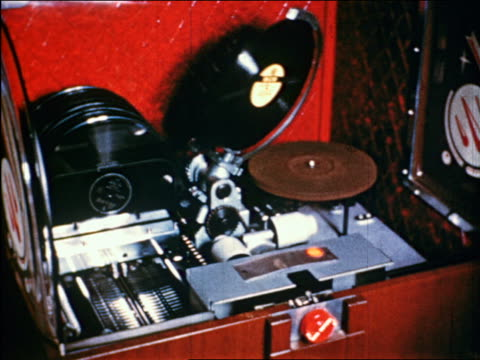 1950 jukebox setting record on player / industrial - jukebox stock videos & royalty-free footage