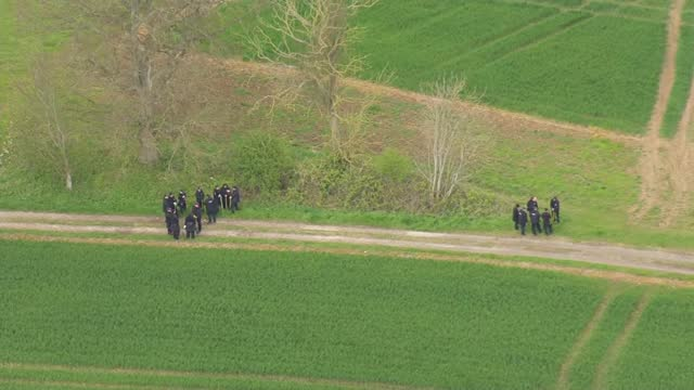 julia james murder: aerials of police search; england: kent: snowdown: ext air views police officers searching countryside / - crime and murder stock videos & royalty-free footage
