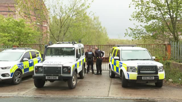 crimestoppers charity offer ten thousand pounds reward; england: kent: ext police vehicles parked outside abandoned coal mine during the search to... - crime and murder stock videos & royalty-free footage