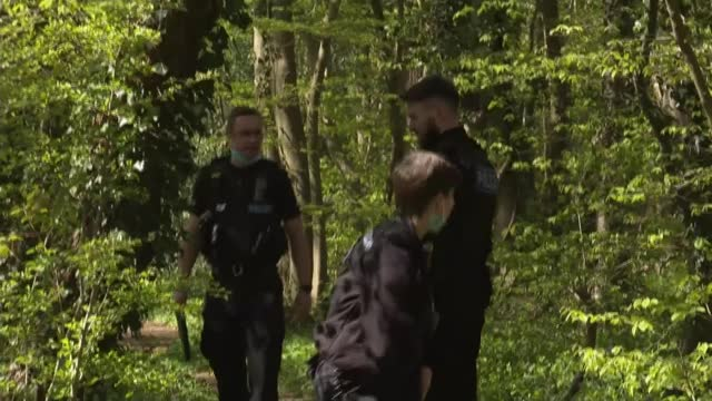 police release photograph of man who 'could be key' in investigation; england: kent: ext various shots of police officers searching woodland - crime and murder stock videos & royalty-free footage