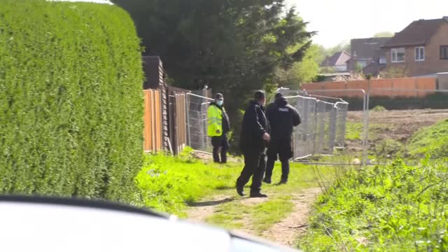 police search forested area; england: kent: ext various shots of police officers gathering for grid search of land next to road / - grid stock videos & royalty-free footage