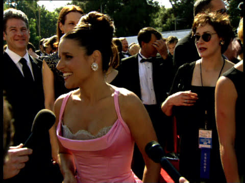 julia louis-dreyfus talks to reporters on the red carpet at the 50th annual emmy awards. - emmy awards stock-videos und b-roll-filmmaterial