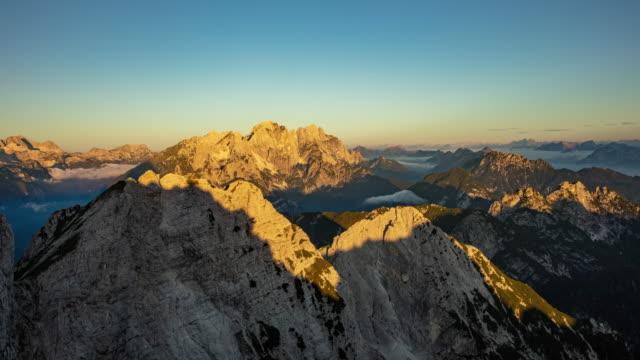 t/l julian alps at sunrise - ridge stock videos & royalty-free footage