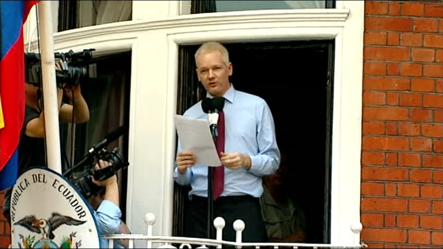 julian assange addresses supporters from balcony of ecuadorian embassy: speech; - i say it must turn back. i ask president obama to do the right... - human back stock videos & royalty-free footage