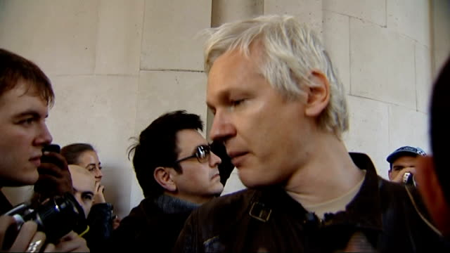 julian assange attends occupy the city protest in city of london; assange speaking to press sot - this is an infamous practice called kettling which... - infamous stock videos & royalty-free footage