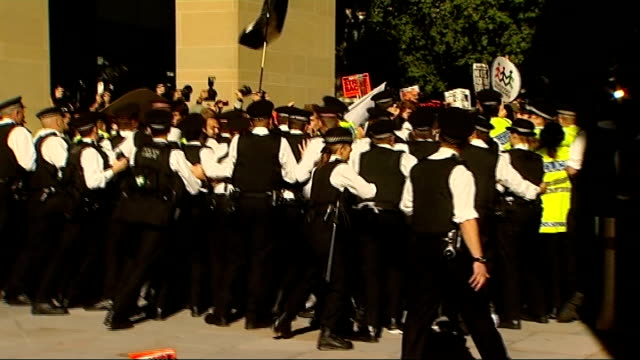 julian assange attends occupy the city protest in city of london; police officers running towards group of protesters held in 'kettle' ** shaky... - shaky stock videos & royalty-free footage