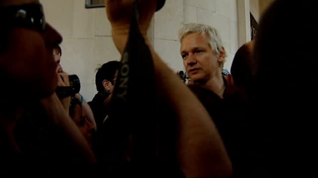 julian assange attends occupy the city protest in city of london; england: london: ext julian assange surrounded by press scrum and and some... - biggest stock videos & royalty-free footage