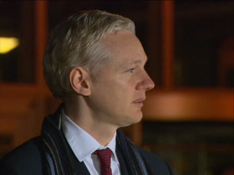 julian assange sot on the attempt to extradite him to sweden. julian assange walks across a lawn with his lawyer mark stephens to microphones to make... - human rights or social issues or immigration or employment and labor or protest or riot or lgbtqi rights or women's rights stock videos & royalty-free footage